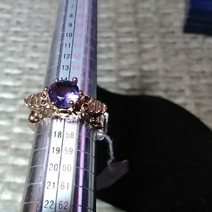 Sz8 purple faceted stone with two tiny skull heads
